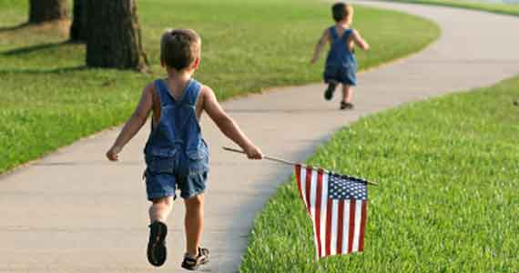 Young Boys running with Flag